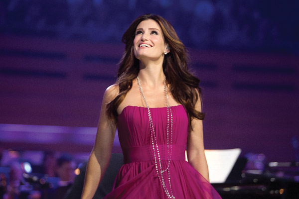 Idina Menzel on stage smiling