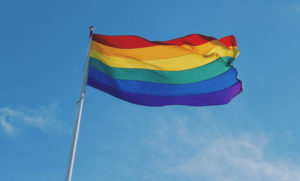 rainbow flag against sky