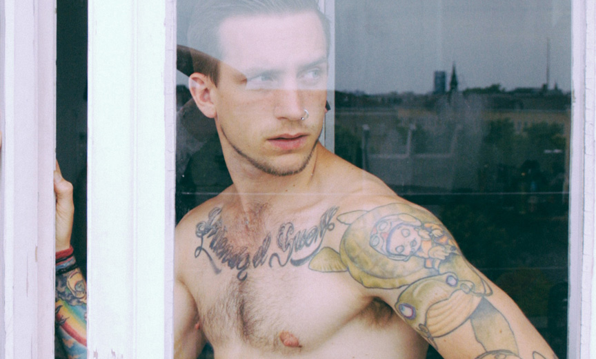 Tattooed Man in Window