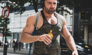 muscle guy drinking kombucha