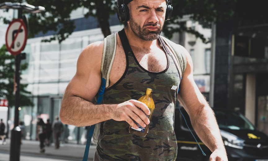 muscular guy walking