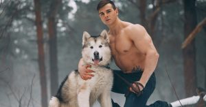 muscular guy with cold weather dog