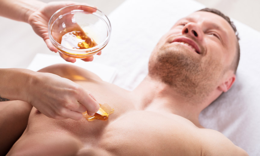 Man Having Honey Put on Skin