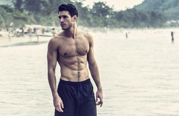 shirtless man in water