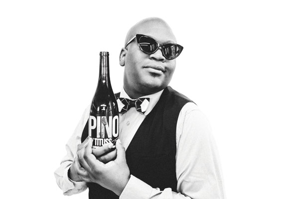 Tituss holding Pinot bottle