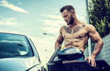Sexy Tattooed Man Getting into Car