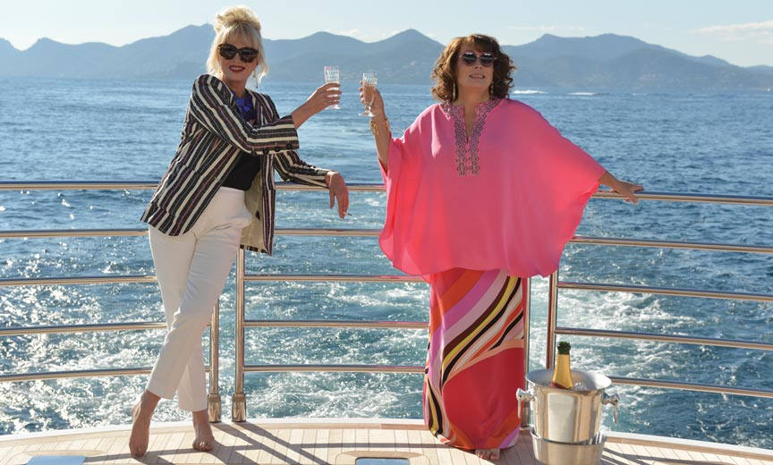 patsy and edina toasting on a ship