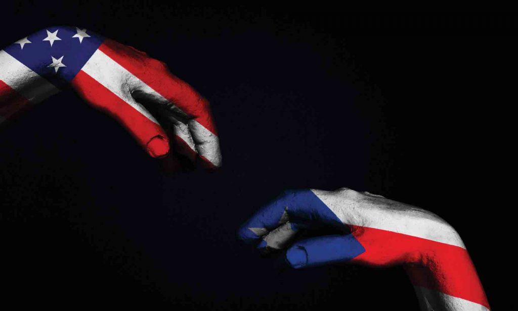US hand reaching to PR