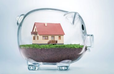 house in glass piggy bank