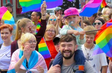 families marching in Pride parade