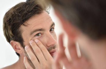 guy examining skin