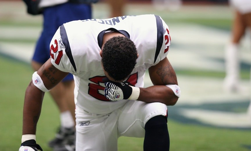 kneeling football player