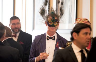Masked guest at AIDS benefit party