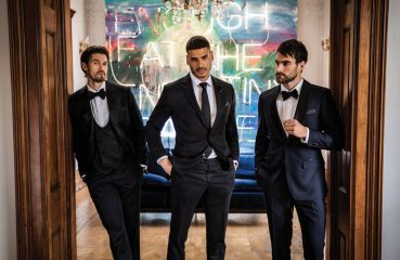 grooms in slick suits