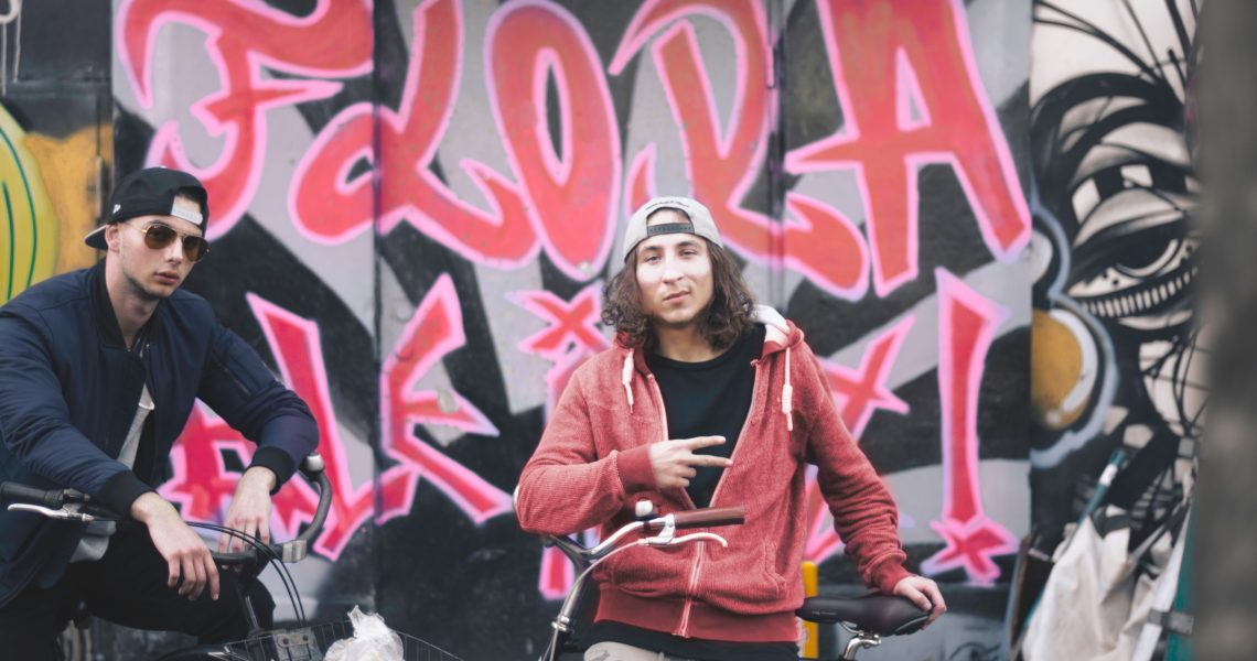 Guys by Graffiti on Bikes