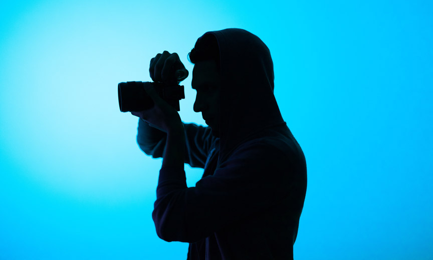silhouette of male photographer