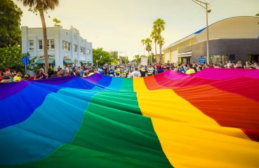 large lgbtq flag in street