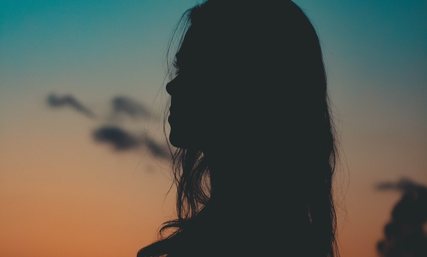 woman in profile at dusk