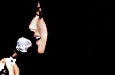 cher profile with microphone circa 1970s