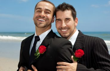 Gay Grooms After a Beach Wedding