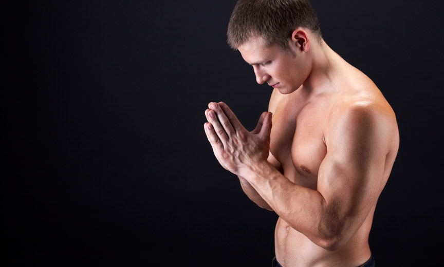 Shirtless Man Praying