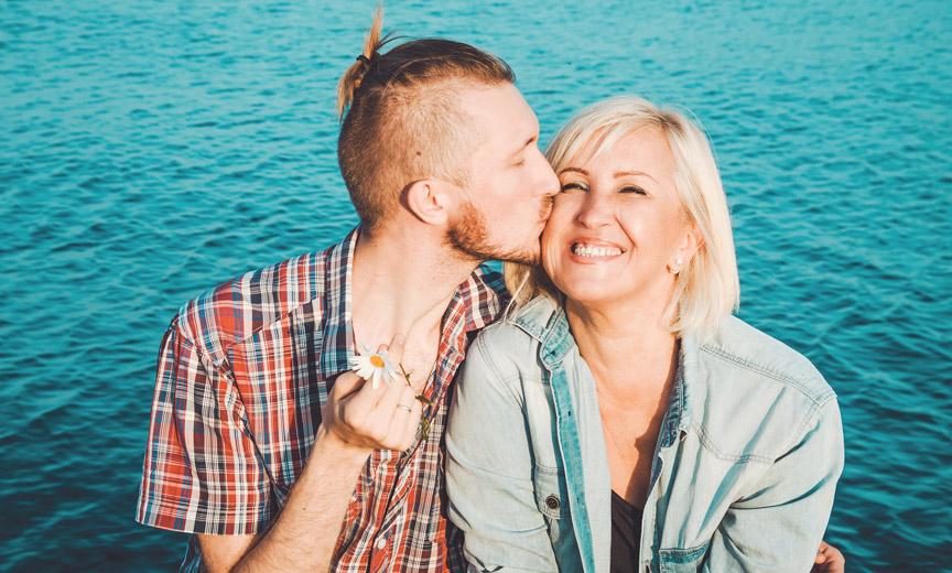 man kissing mother