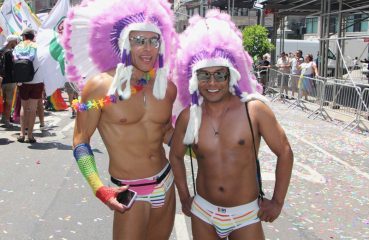 gay men with native american headdresses