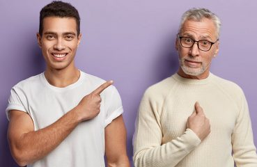 young man pointing to older man