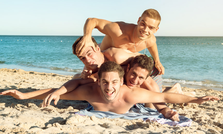 Four Boys Having Fun on the Beach