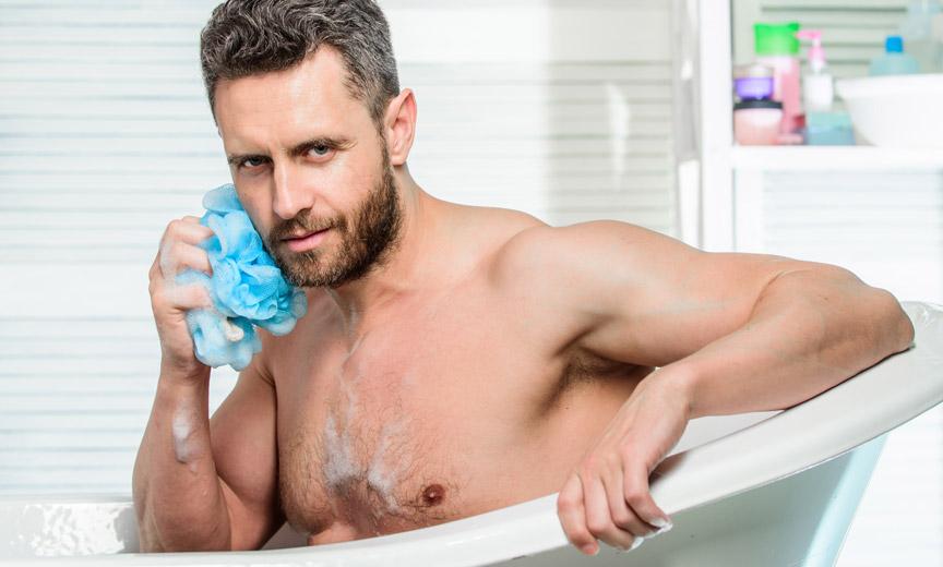 Man Bathing with Aqua Pouf