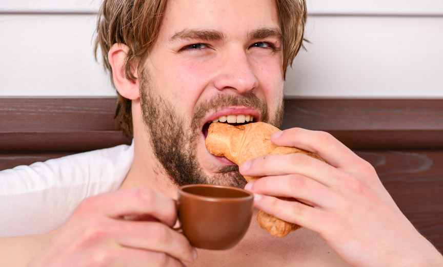 Man Enjoys Coffee and Pastry