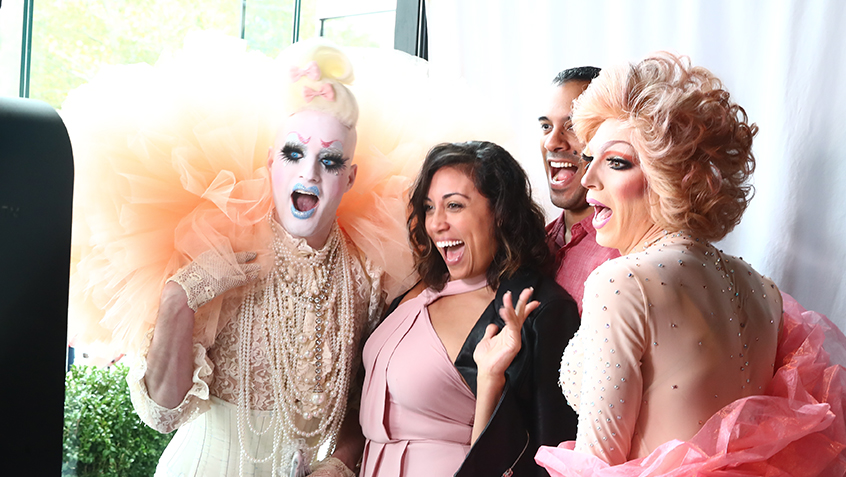 posing with drag queens