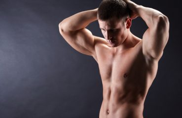 Shirtless man posing