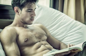 Shirtless Man Reading