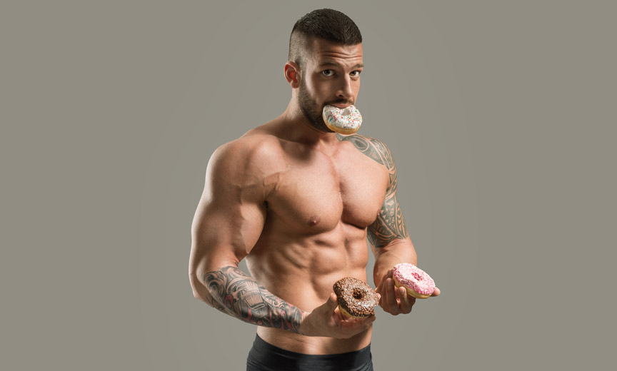 muscle guy eating donuts