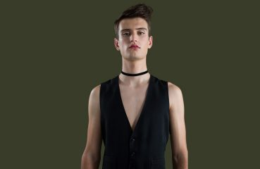 gender fluid person in vest