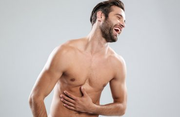 Shirtless Man Laughing