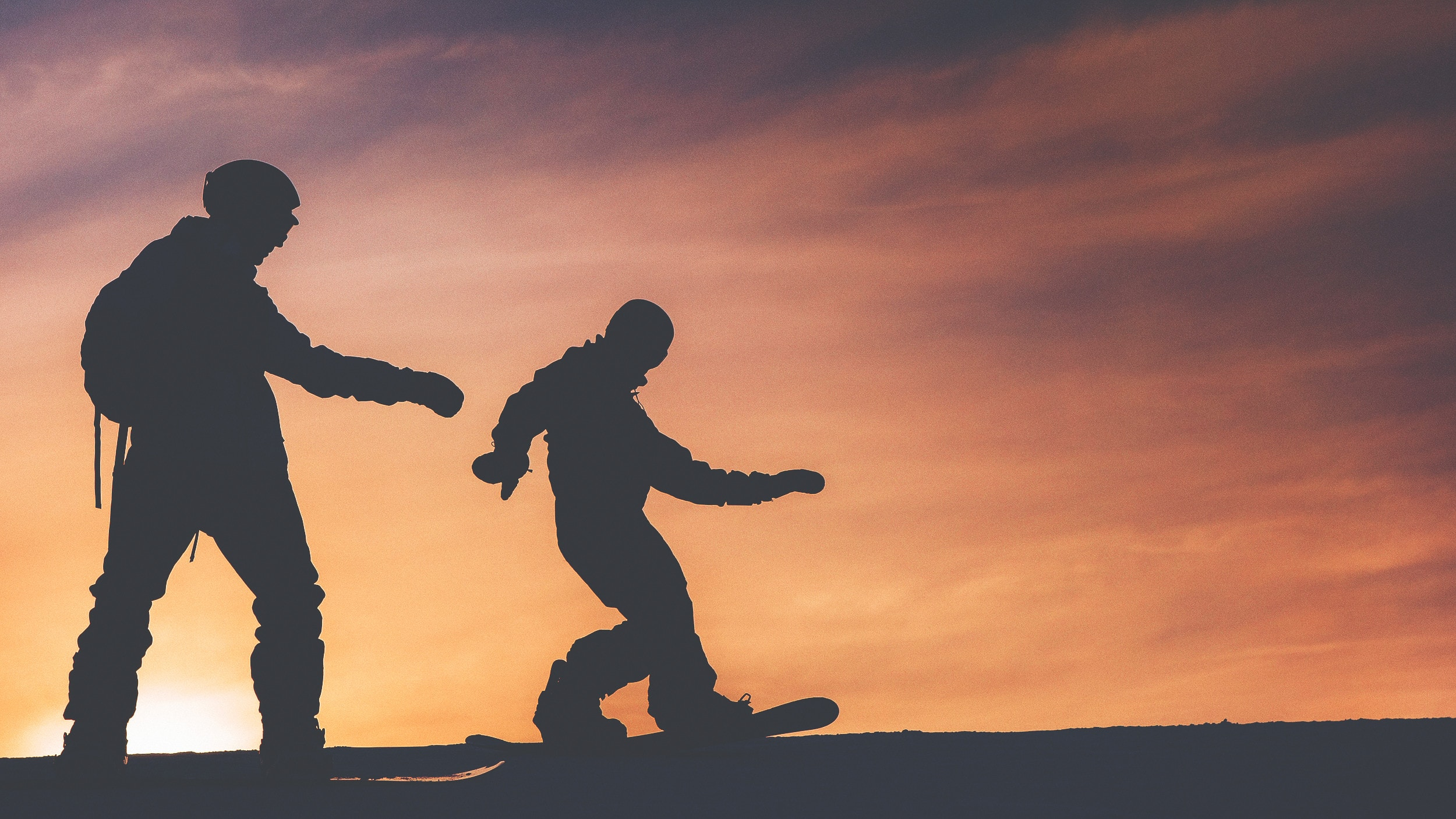 snowboarding at sunset