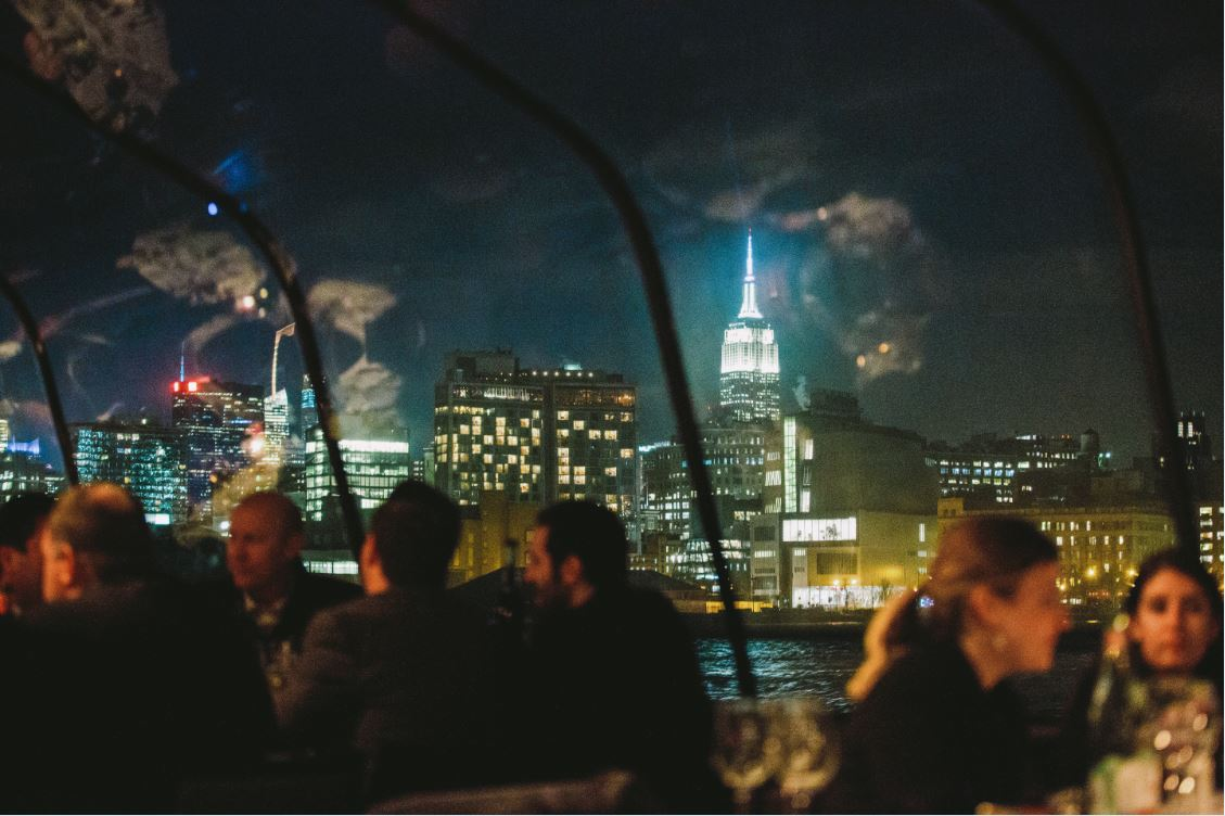 dining with nyc skyline in background
