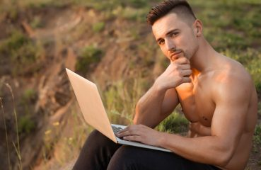 Shirtless Man Enjoying Reddit