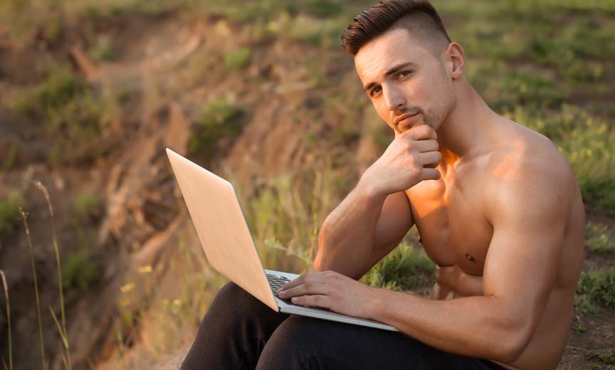 Shirtless Man Enjoying Reddit
