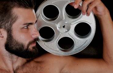 Handsome Man with Film Reel
