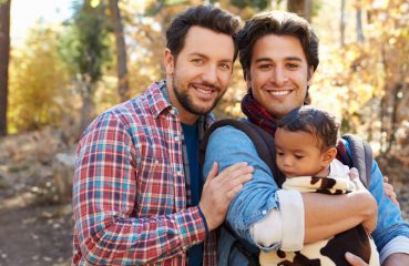 Gay Dads in the Forest with a Baby