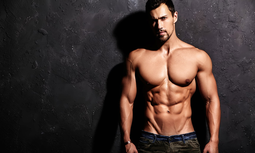 Shirtless Man Against Dark Wall
